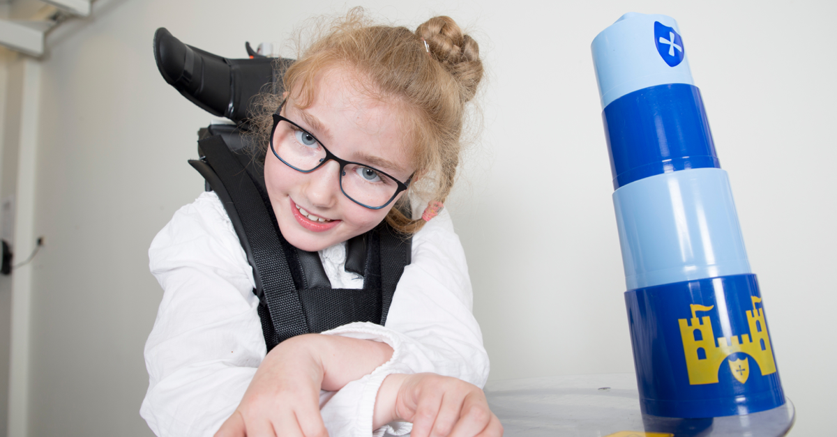 Girl with CP in helping aid. Botox for cerebral palsy – does it help?