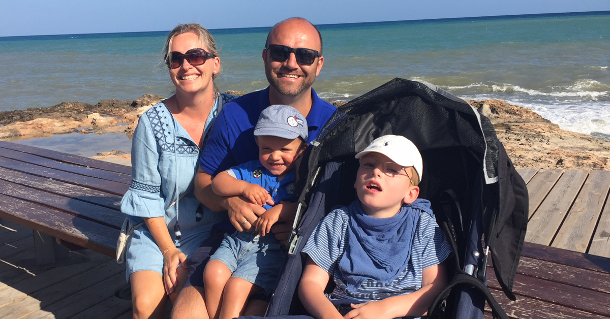 Family with disabled child on vacation. Having a child with disabilities: Living, challenges and finding time for yourself