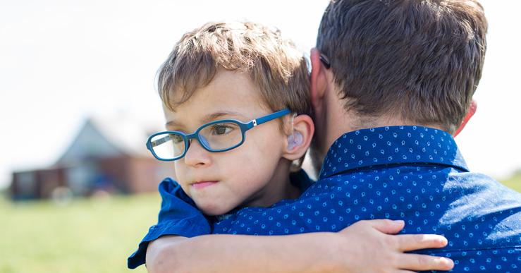 Boy hugging his dad. How does  family-centered services make a difference