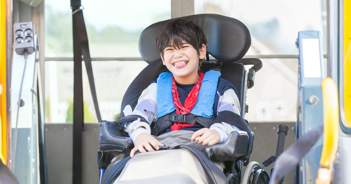 Smiling boy in assistive device. What is gmfcs, and why is it used?