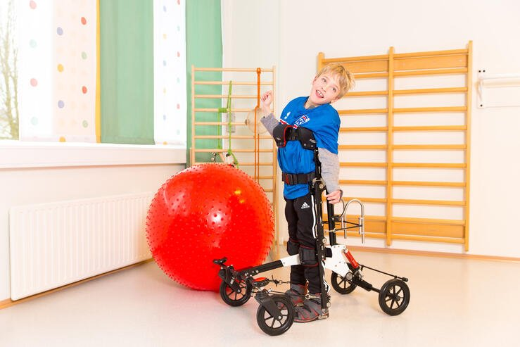 Young boy is standing in his NF-Walker