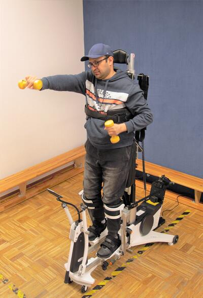 Man is training with weights in the Innowalk Pro